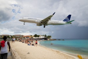 A Copa Airlines Airbus lands on Runway 10 at Princess Juliana Airport on Sint Maarten giving beach-goers quite a show