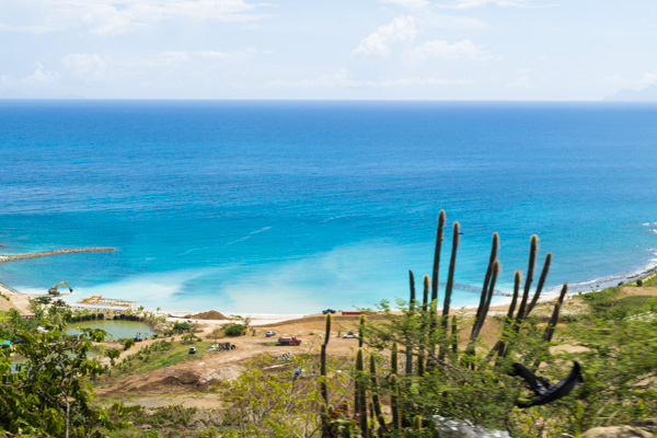 The waters of the Caribbean are clear and coral blue - as seen from AJC Brower Rd on Sint Maarten
