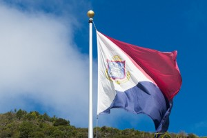 The flag of Sint Maarten, a 'new country within the Kingdom of the Netherlands.' Its colors are the same as the Dutch flag and is similar to the Philippine wartime flag.