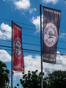 Advertising banners for the Bahamian Brewery and Beverage Co outside a beer store on Nassau