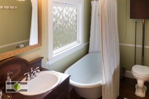 The bathroom, featuring a clawfoot tub, of a Phinney Ridge Craftsman-style Nice Seattle Home - Listing soon! ©2014 Ari Shapiro - AShapiroStudios.com