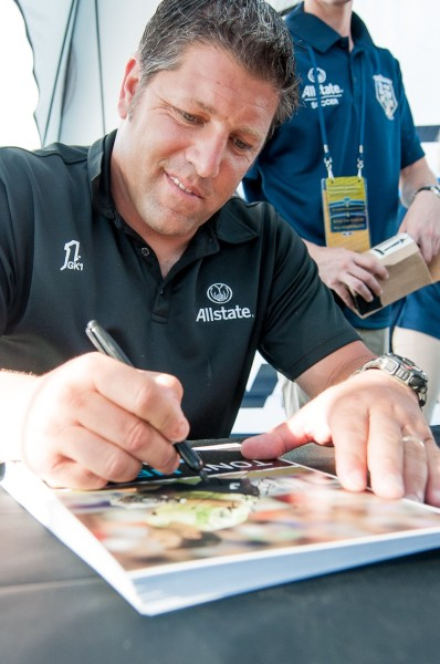 Soccer Legend Tony Meola signs autographs for fans in the Allstate Fan Village at the MLS All Star Game in 2012.  Event Photography by Ari Shapiro - AShapiroStudios.com