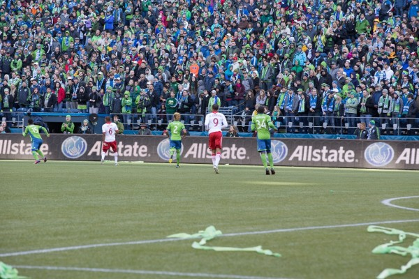 The crowd was on their feet through the entire match as the Seattle Sounders FC spared against the Portland Timbers for MLS play in 2013.  Event Photography by AShapiroStudios.com