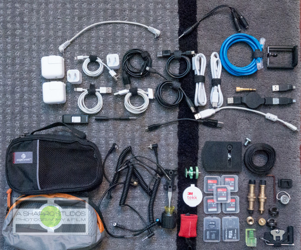 Small cables, adapters, chargers, etc - the accessories I travel with.  Photography by Ari Shapiro - AShapiroStudios.com