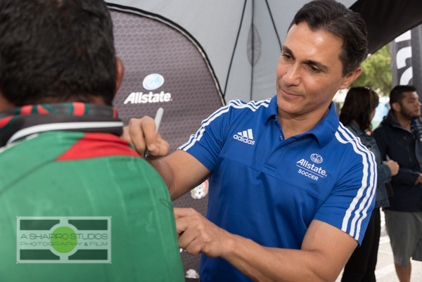 Mexico goalkeeping legend Adolfo Rios shook hands, posed for pictures and signed autographs for Allstate in the fan village outside NRG Stadium before the Mexico vs Honduras match. Houston Event Photography ©2015 Ari Shapiro - AShapiroStudios.com