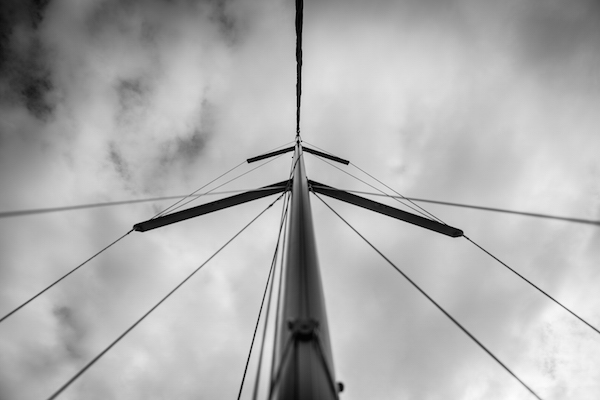The mast stands tall on this 38' Defour with ominous skies and a halyard slapping against the pole. Fine Art Metallic Print from AShapiro Studios